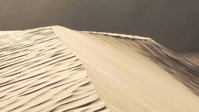 ms pan wind blowing across sand dune / san pedro de atacama, norte grande, chile - antofagasta region stock videos and b-roll footage