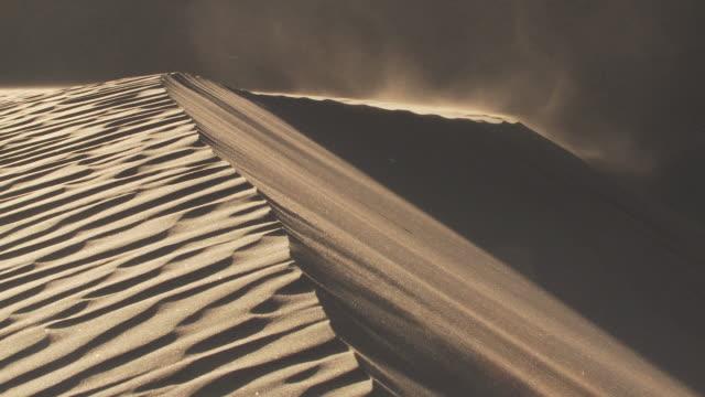 WS Wind blowing across sand dune / San Pedro de Atacama, Norte Grande, Chile