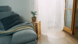 DS Wind blowing through a curtain in a living room