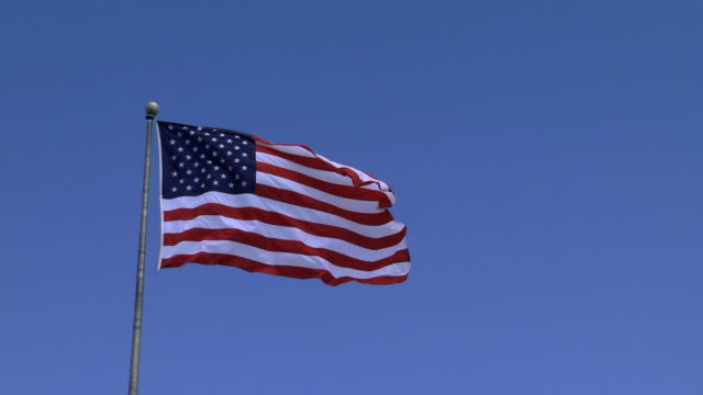wind blown flag - flag blowing in the wind stock videos & royalty-free footage