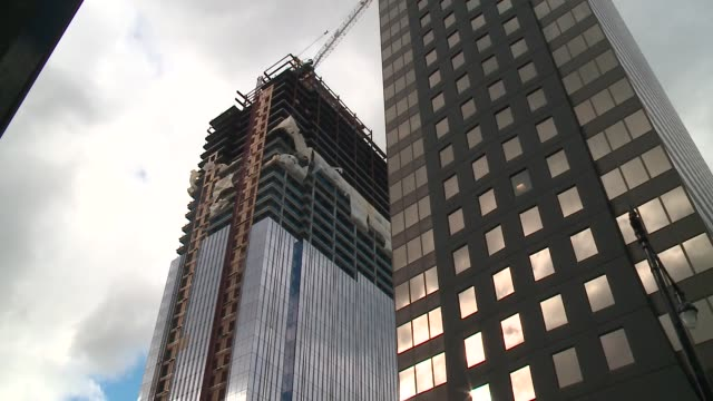 wgn wind blows around plastic sheet on high rise construction site in chicago heavy winds hit downtown chicago on february 19 2016 causing class to... - gale stock videos and b-roll footage