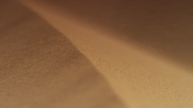 wind blows sand over crest of desert dune, uae - sand dune stock videos and b-roll footage