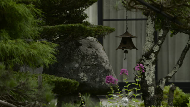 wind chime hangs from tree, japan. - metal clip stock videos and b-roll footage