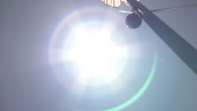 wind chime swinging by wind under fair sky, niigata, japan - record breaking stock videos & royalty-free footage