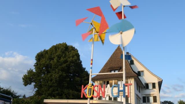 wind chime with a name sign of the municipality of kuesnacht stands at the lower eastern shore of the lake of zürich, also called goldcoast during... - identity stock-videos und b-roll-filmmaterial
