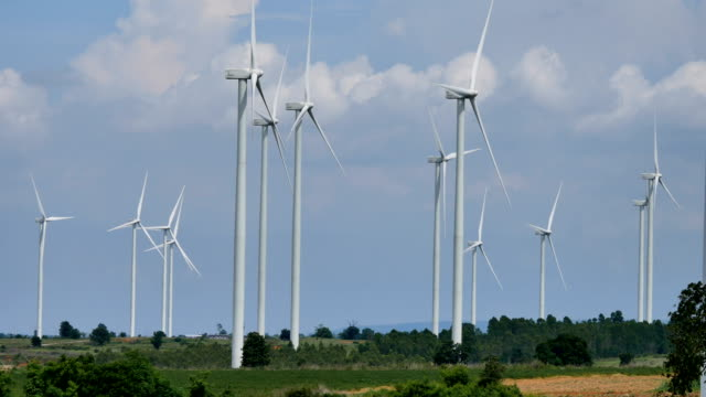 wind energy turbines are one of the cleanest, renewable electric energy source. electricity is generated by electric generators hidden inside turbine.timelaps - land vehicle stock videos & royalty-free footage
