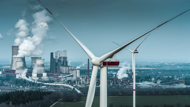 wind energy versus coal fired power station - aerial view - coal stock videos & royalty-free footage