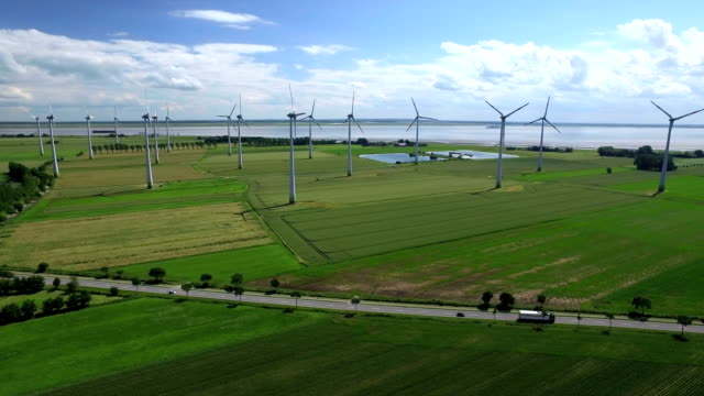 wind farm aerial view - verkehrsweg stock-videos und b-roll-filmmaterial