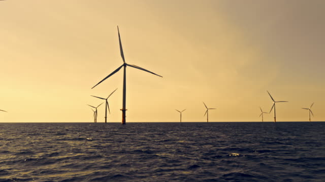 aerial wind farm at sea in setting sun - denmark stock videos & royalty-free footage