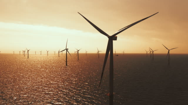 aerial wind farm at sea in sunset - dusk stock videos & royalty-free footage