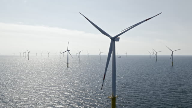 aerial wind farm at sea in sunshine - propeller stock videos & royalty-free footage
