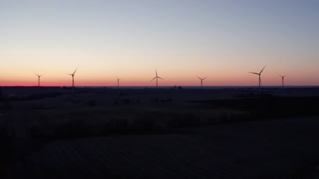 wind farm at sunset - aerial - illinois stock videos and b-roll footage