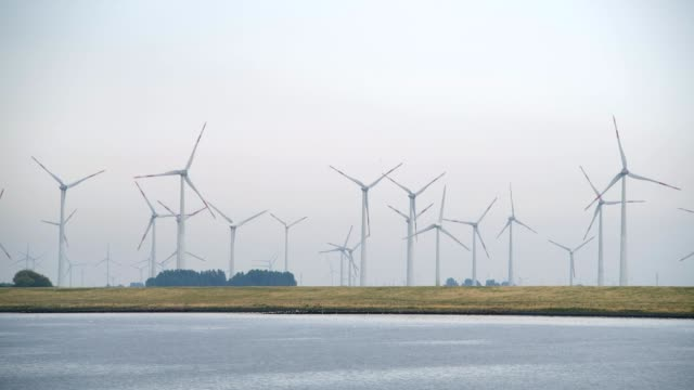 wind farm at the north sea, north sea, schleswig-holstein, germany - windkraftanlage stock-videos und b-roll-filmmaterial