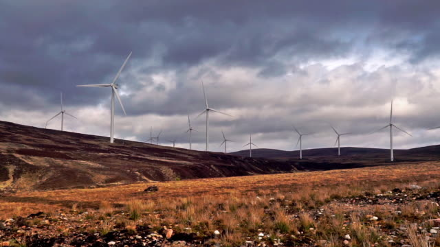 wind farm generating clean renewable energy - carbon footprint stock videos and b-roll footage