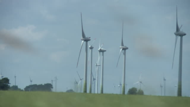 ms pov  wind farm in rural landscape / st. peter-ording, schleswig holstein, germany - schleswig holstein stock-videos und b-roll-filmmaterial