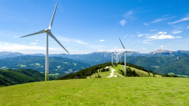 Wind farm in the alps - aerial view - source file cinema dng
