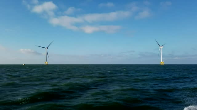 a wind farm off the suffolk coast - horizon over water stock videos & royalty-free footage