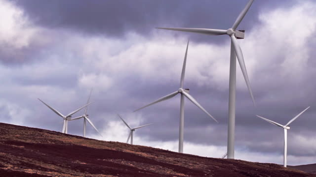 wind farm turbines generating renewable energy in scottish highlands - carbon footprint stock videos and b-roll footage