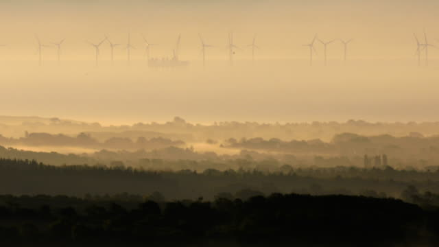 wind farms off the south coast rotate as mist hangs in the valley near amberley in the south downs national park on october 3, 2018 in amberly,... - fog stock videos & royalty-free footage