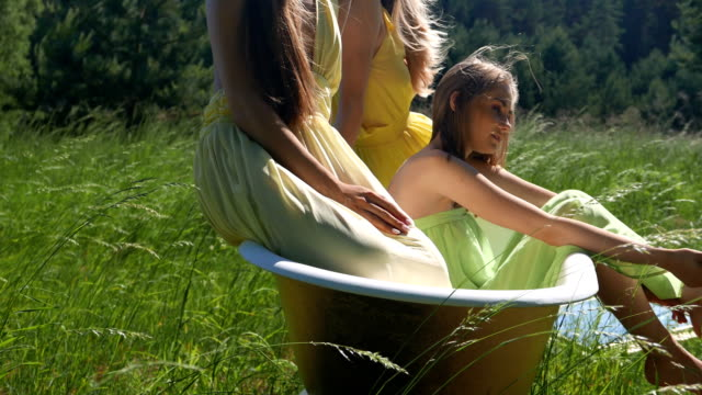 wind, hair and girls in the tub. - taking a bath stock videos & royalty-free footage