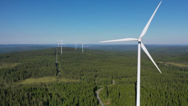 wind power stations in a forest landscape - remote location stock videos & royalty-free footage