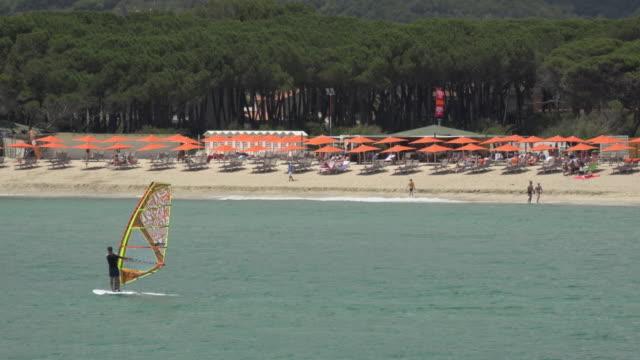 Wind surfer at beach of Marina di Campo
