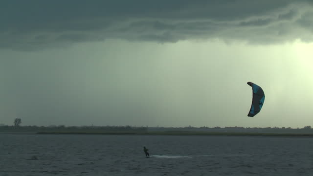 wind surfing in a thunderstorm - scott mcpartland stock videos & royalty-free footage