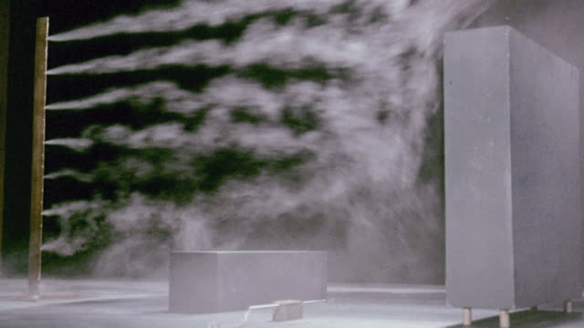 vídeos de stock, filmes e b-roll de montage wind tunnel experiment using smoke to show wind patterns at the building research establishment / garston, england, united kingdom - tunnel