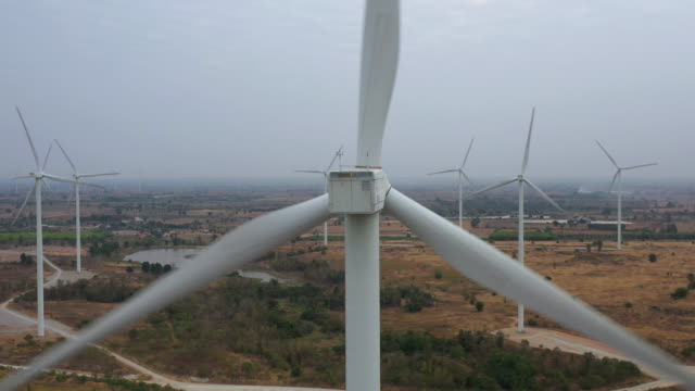 wind turbine aerial view zoom out - blade stock videos & royalty-free footage