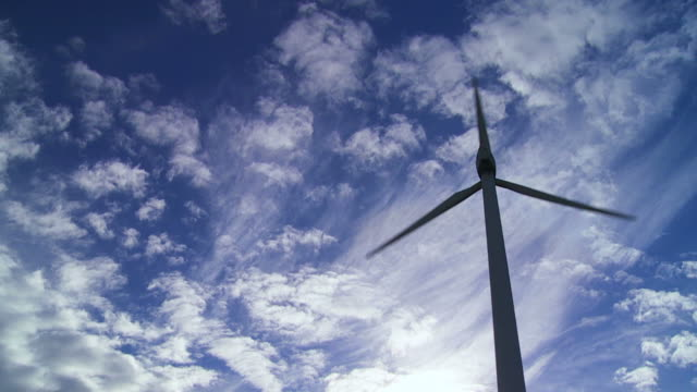 wind turbine against coudy sky - stimmungsvoller himmel stock videos & royalty-free footage