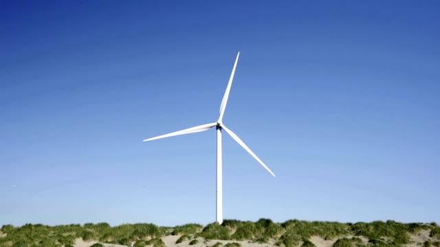 stockvideo's en b-roll-footage met wind turbine against sky - noord holland