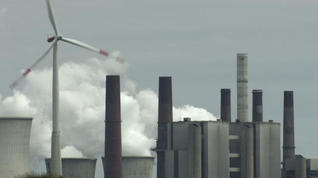 wind turbine and coal power plant - luftverschmutzung stock videos & royalty-free footage