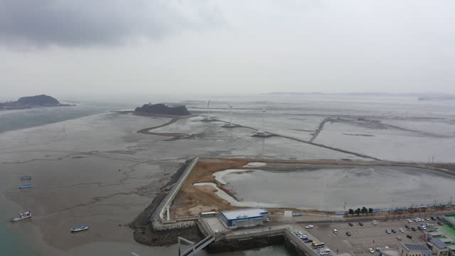 wind turbine and mud flat nearby nueseom island and tandohang port in ansan city / ansan-si, gyeonggi-do, south korea - anchored stock videos & royalty-free footage
