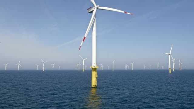 aerial wind turbine at an offshore wind farm - wind turbine stock videos & royalty-free footage