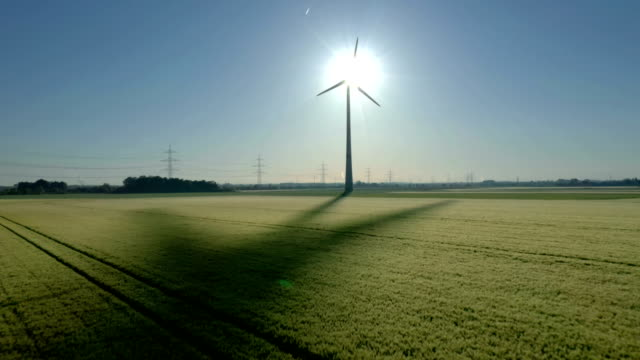 wind turbine at sunrise - turbine stock-videos und b-roll-filmmaterial