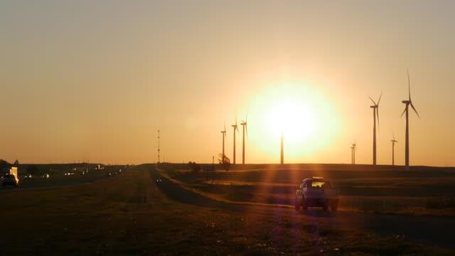 wind turbine at sunrise - oklahoma stock-videos und b-roll-filmmaterial