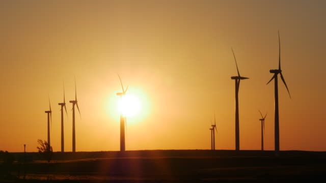 wind turbine at sunrise - oklahoma stock videos & royalty-free footage