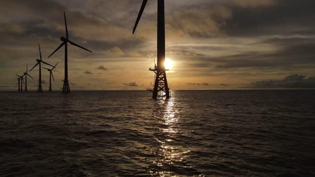 wind turbine at sunset / jeju-do, south korea - turbine stock videos & royalty-free footage