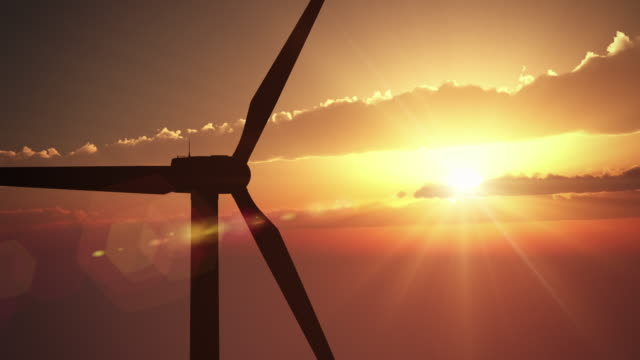 wind turbine at sunset | loopable - wind power stock videos and b-roll footage