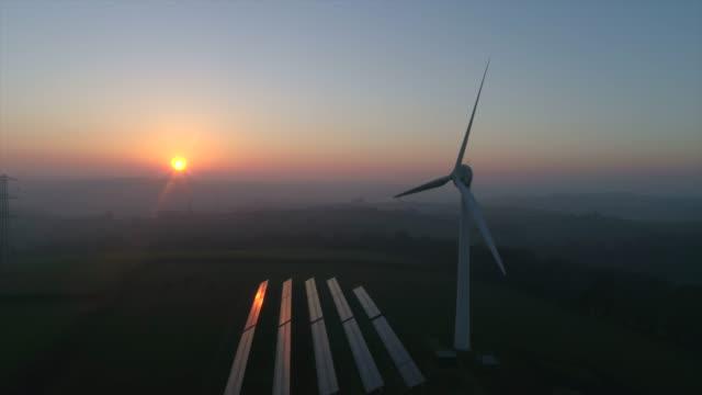 wind turbine at sunset - solar panel stock videos & royalty-free footage