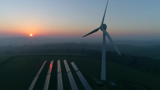 wind turbine at sunset - dramatic sky stock videos & royalty-free footage