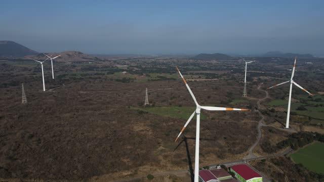 wind-turbine-at-susan-town-in-seongsan-county-seogwiposi-jejudo-south-video-id1298219243