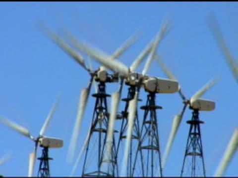 wind turbine blue cu (dv) - medium group of objects stock videos & royalty-free footage