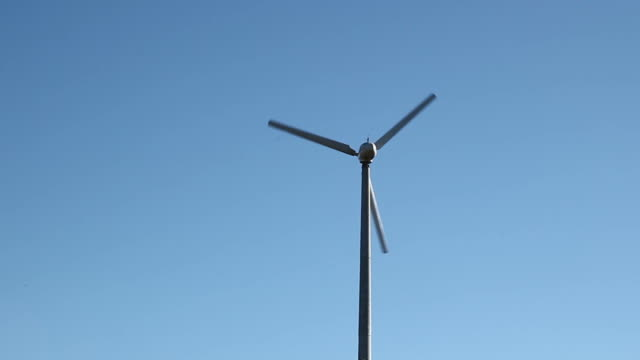 Wind turbine, blue sky.