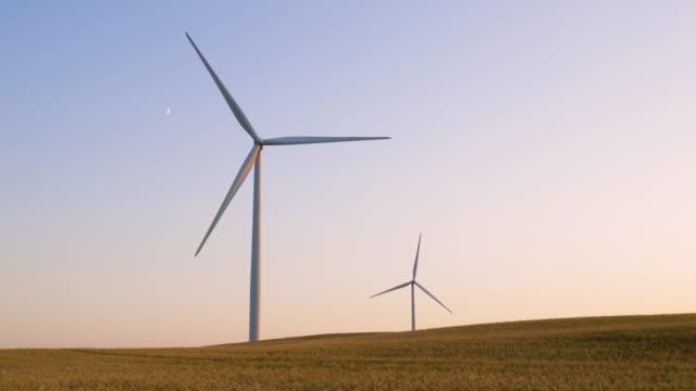 a wind turbine. electricity wind generator - turbine stock videos & royalty-free footage