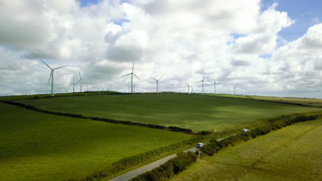 wind turbine fields in cornwall - 4k - cornwall england stock videos & royalty-free footage