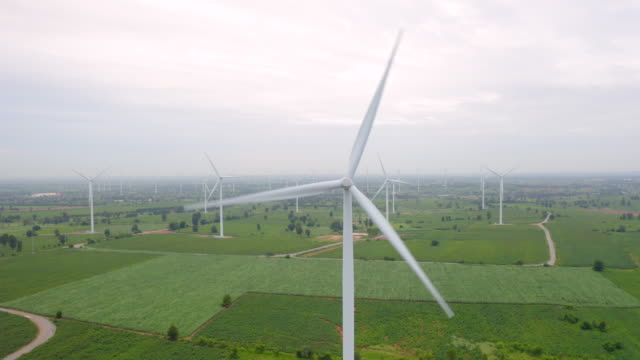 wind turbine from aerial view in moring - sustainable development, environment friendly, renewable energy concept. - mill stock videos & royalty-free footage
