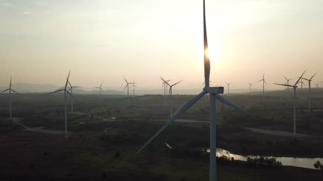 wind turbine from aerial view on sunset - wind turbine stock videos and b-roll footage