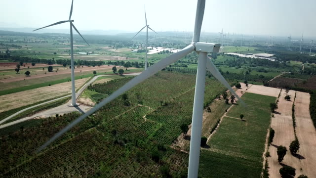 wind turbine generating electricity energy production with clean and renewable energy - power in nature stock videos and b-roll footage