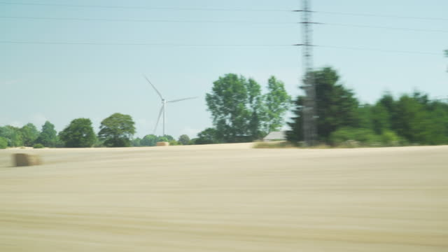 wind turbine in denmark while taking bus to copenhagen city in summer - road stock videos & royalty-free footage